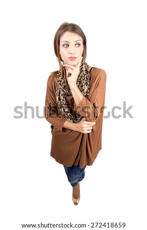 Young pensive beauty looking away with finger on her chin. High angle view wide lens full body length portrait isolated over white background - stock photo