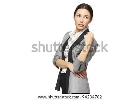 Young pensive female holding eyeglasses looking sideways, isolated on white background - stock photo