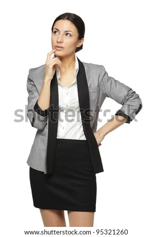 Young pensive female looking sideways, isolated on white background - stock photo