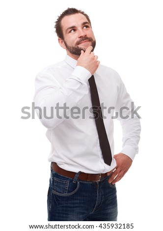Young pensive man in a white shirt on a white background
