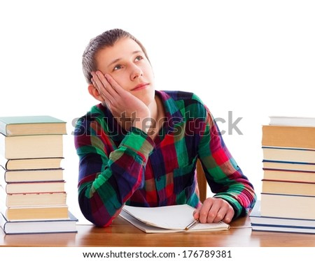 Young pensive student daydreaming instead of learning. - stock photo