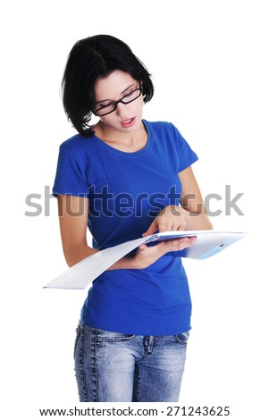 Young pensive student reading her notes. - stock photo