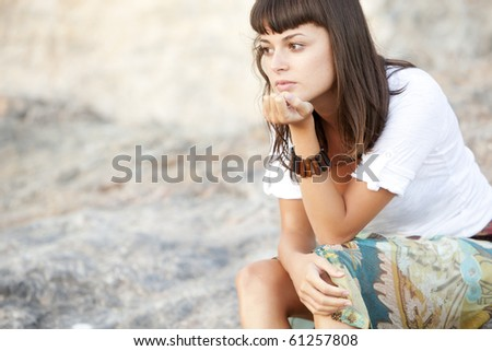 Young pensive woman close portrait in pensive gesture. - stock photo