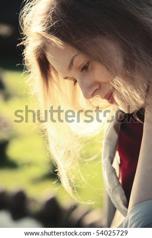 Young pensive woman outdoors portrait. - stock photo
