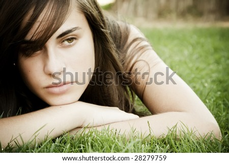 Young pensive woman portrait - stock photo