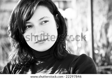 Young pensive woman portrait, black and white version. - stock photo