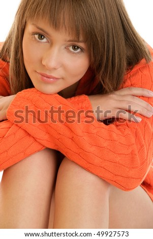 Young pensive woman smiling - stock photo