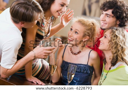 Young people are chatting at an evening-party - stock photo