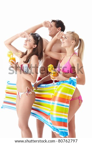 Young people are looking into the distance with a cocktail on a white background - stock photo