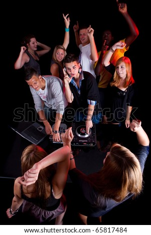 Young people at a party with two young djs. - stock photo