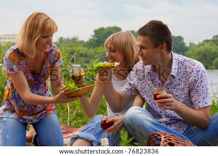 Young people at the picnic - stock photo