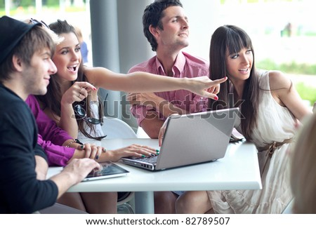 Young people browsing internet on a coffee break - stock photo