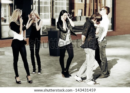 Young people calling on the mobile phones - stock photo