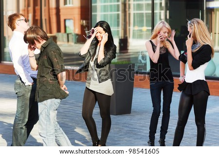Young people calling on the mobile phones. - stock photo