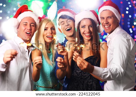 Young people celebrating Christmas in club - stock photo