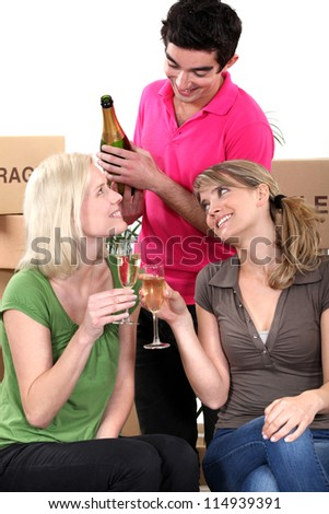 Young people celebrating on moving day - stock photo