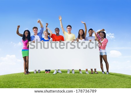 Young People Celebrating with Blank Billboard - stock photo
