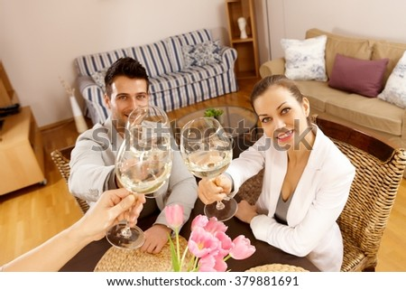 Young people celebrating with champagne. - stock photo