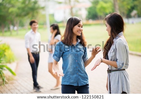 Young people communicating outdoors - stock photo