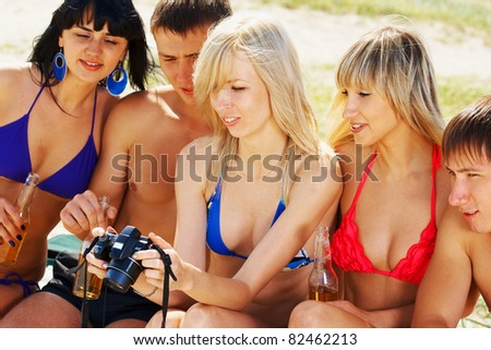 Young people company in summer sunlight day on the beach - stock photo