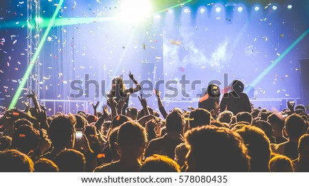 Young people dancing at night club - Hands up and multicolored confetti at nightclub after party - Nightlife concept with afterparty crowd celebrating dj concert festival event - Retro contrast filter