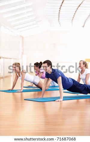 Young people do push-ups in the Gym - stock photo