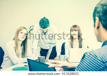 Young people employee workers in bad moment of tough crisis- Business concept of human resource and trouble on working time - Start up entrepreneur facing failure - Cross processing desaturated filter - stock photo
