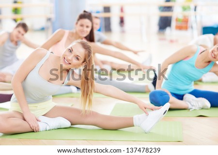 Young people engage in a fitness club - stock photo