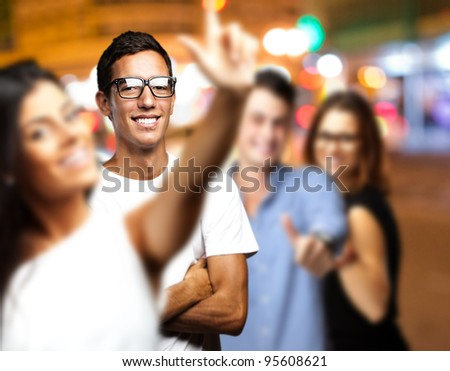 young people enjoying at city by night - stock photo