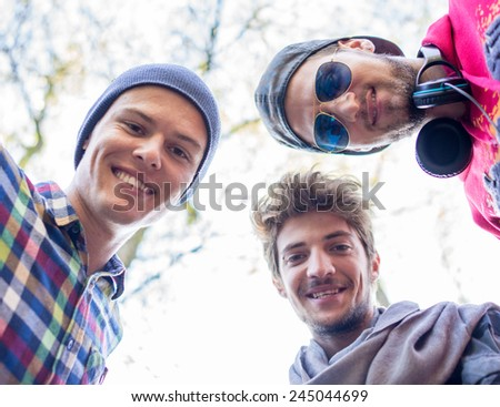 Young people enjoying in beautiful park at river - stock photo
