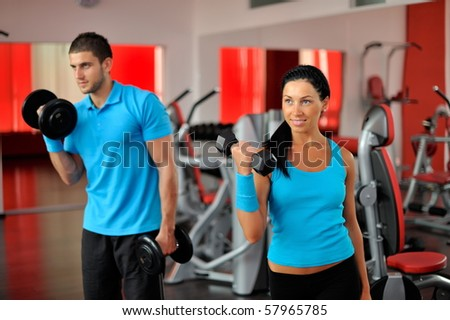 young people exercising in the gym