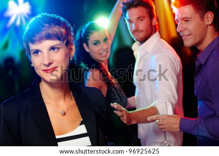 Young people, friends in the nightclub, dancing, having fun.? - stock photo
