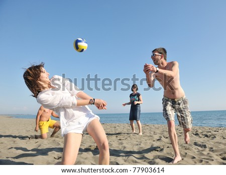 young people group have fun and play beach volleyball at sunny summer day - stock photo