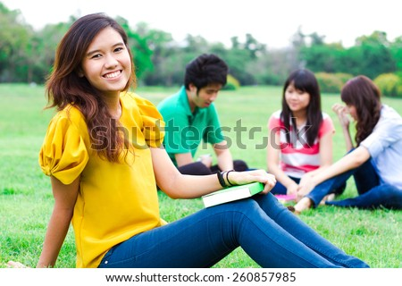Young people hanging out in the park. - stock photo
