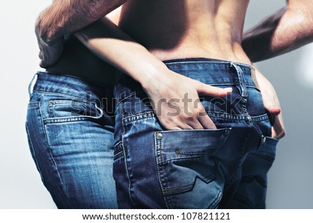 Young people hardly restraining their temper being together - stock photo