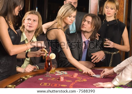 Young people have a good time in casino - stock photo