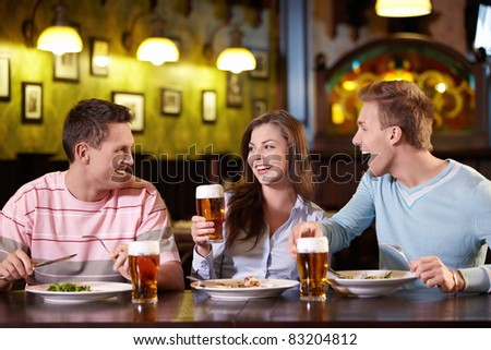 Young people have dinner at a restaurant - stock photo