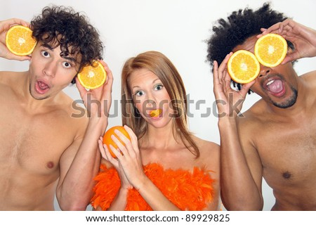 Young people have fun with oranges - stock photo