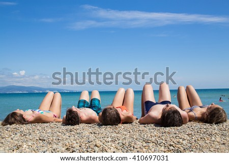 young people have sunbathing on the   beach - stock photo