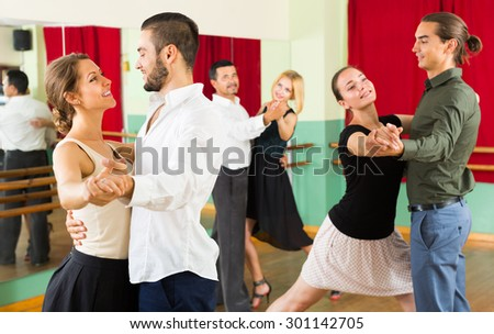 young  people having dancing class in studio - stock photo