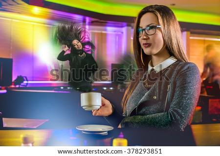 Young people having fun at night club. Confident girl drinking hot coffee - stock photo