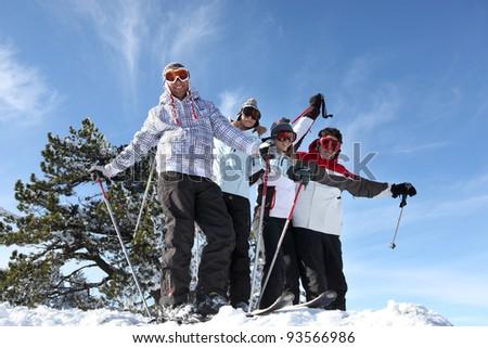 Young people having fun at ski holidays - stock photo