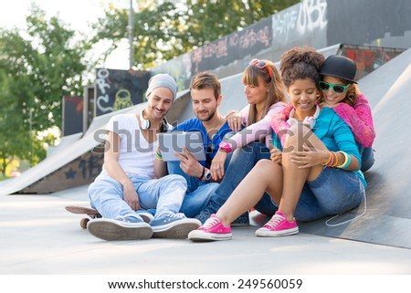 Young people having fun at the skate park
