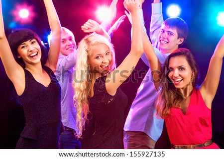 Young people having fun dancing at party. - stock photo