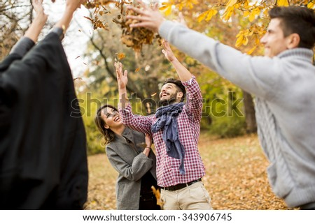 Young people having fun in the autumn park