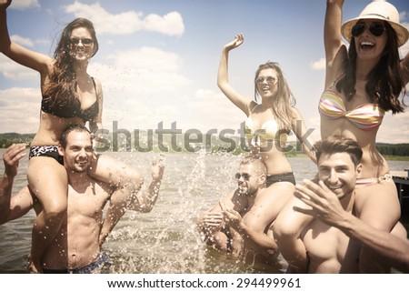 Young people having fun in the lake - stock photo