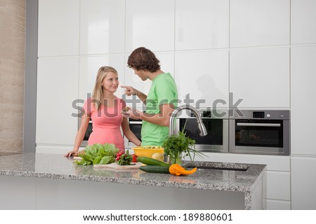 Young people having romantic date in home
