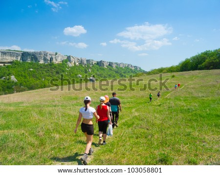 Young people hike in Crimea mountains - stock photo