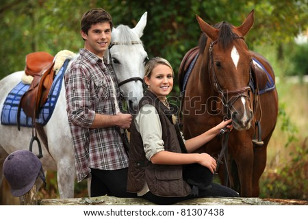 Young people horseriding - stock photo