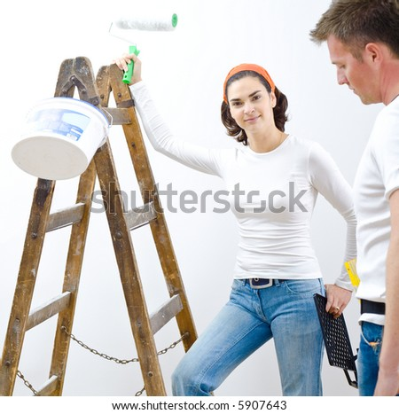 Young people improving their home. - stock photo
